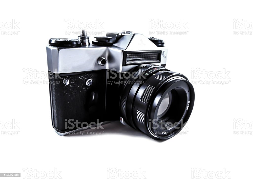 Old photo camera isolated on white background stock photo