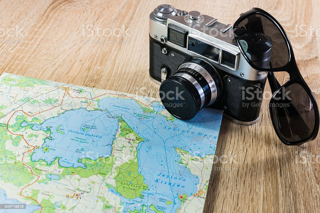 Old photo camera, paper map and sunglasses. Color photo stock photo