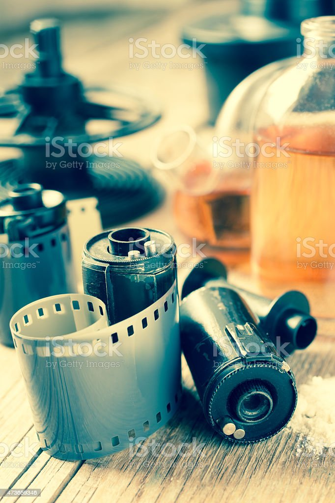 Old photo film rolls, cassette and photographic equipment stock photo