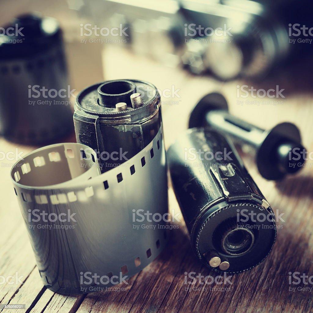 Old photo film rolls, cassette and retro camera. stock photo