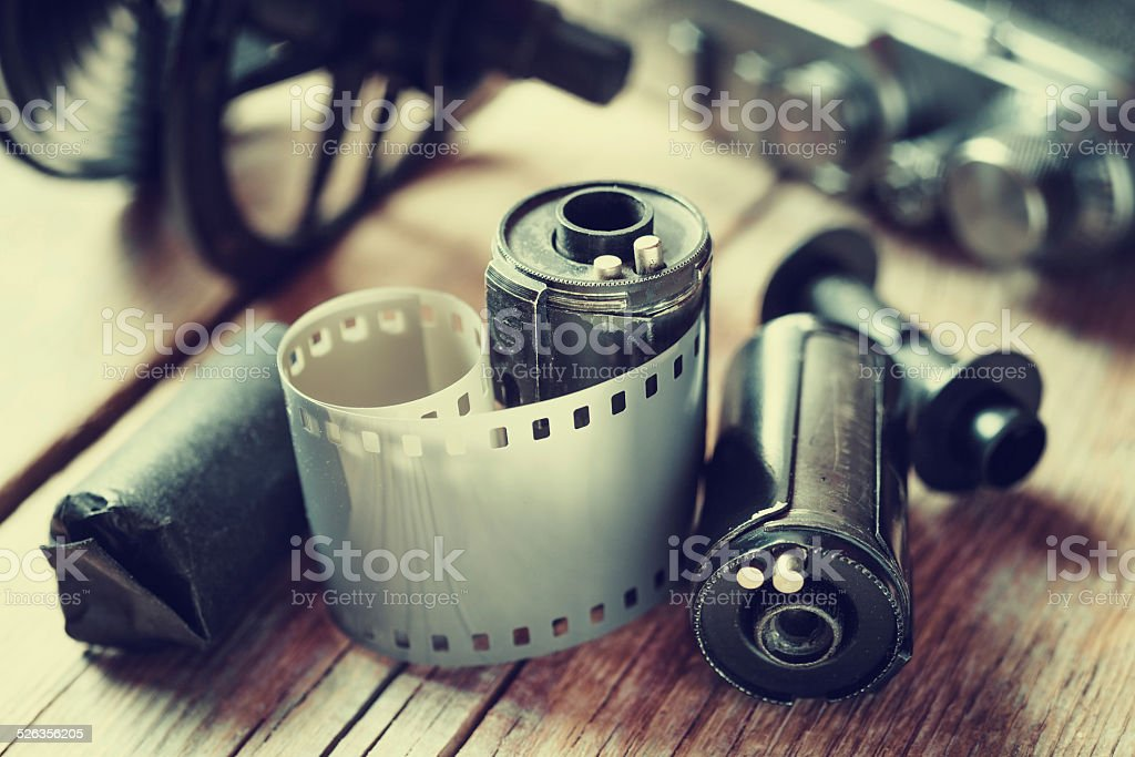 Old photo film rolls, cassette and retro camera. stock photo