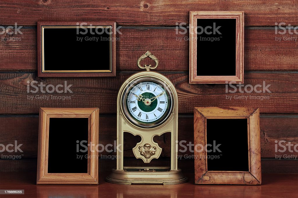old photo frames and antique clock royalty-free stock photo