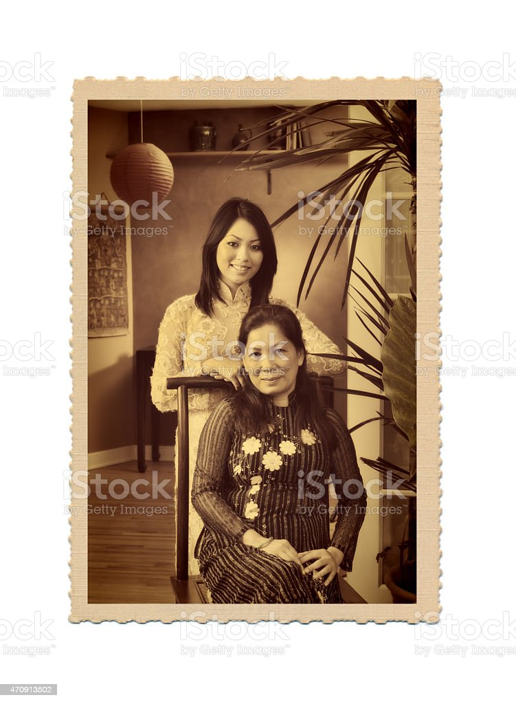 Old Photo of Asian Vietnamese Family in Traditional Home stock photo