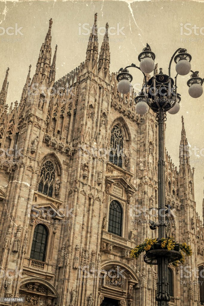 Old photo with facade of the famous Milan Cathedral, Lombardy, Italy stock photo