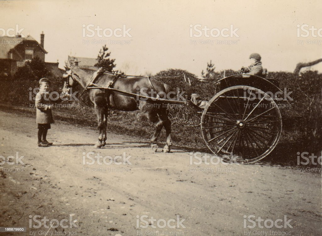 Old Photograph Two Boys and Carriage stock photo
