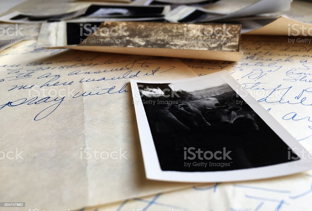 Old Photographs on Old Handwritten Letters stock photo