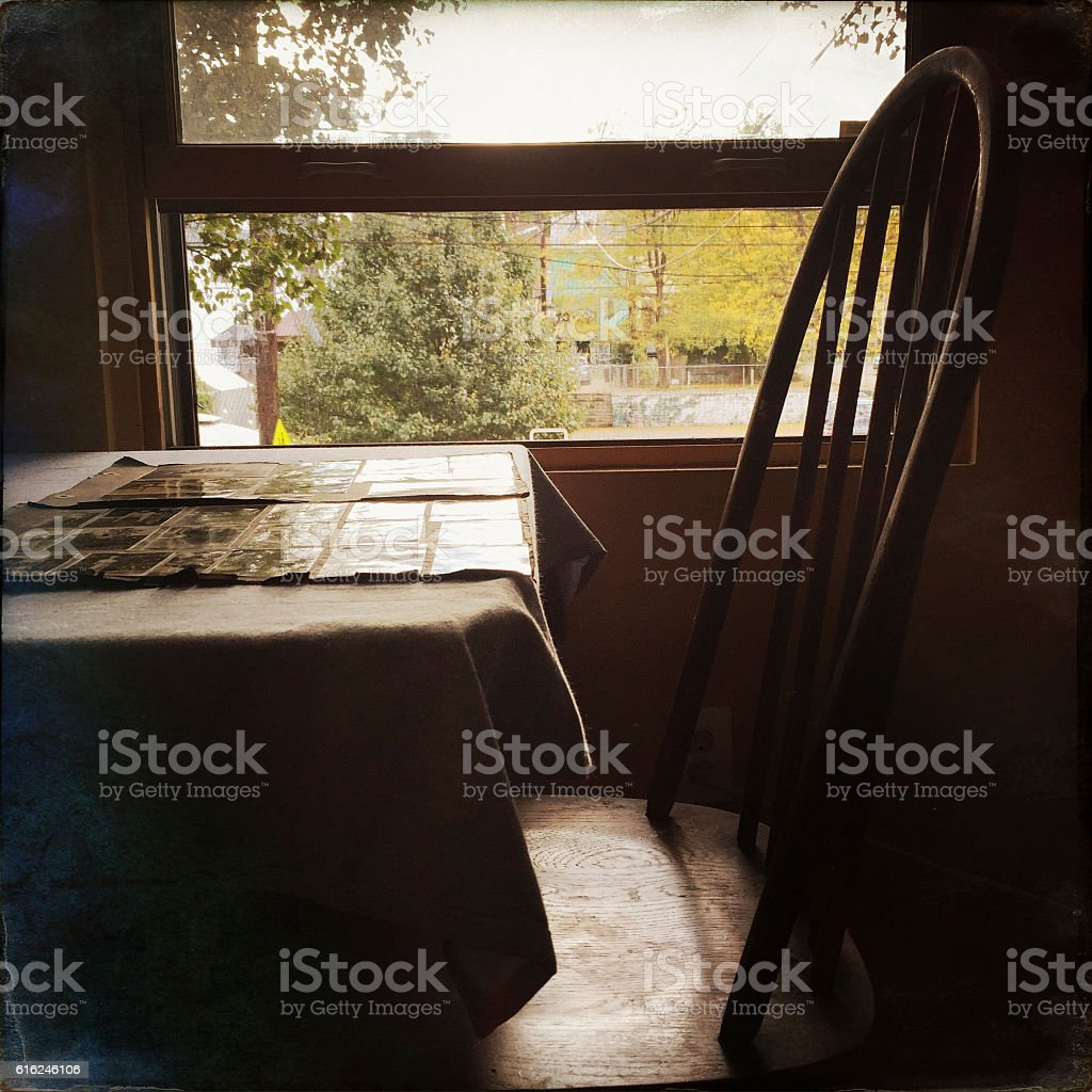 Old Photographs on Table by Window stock photo