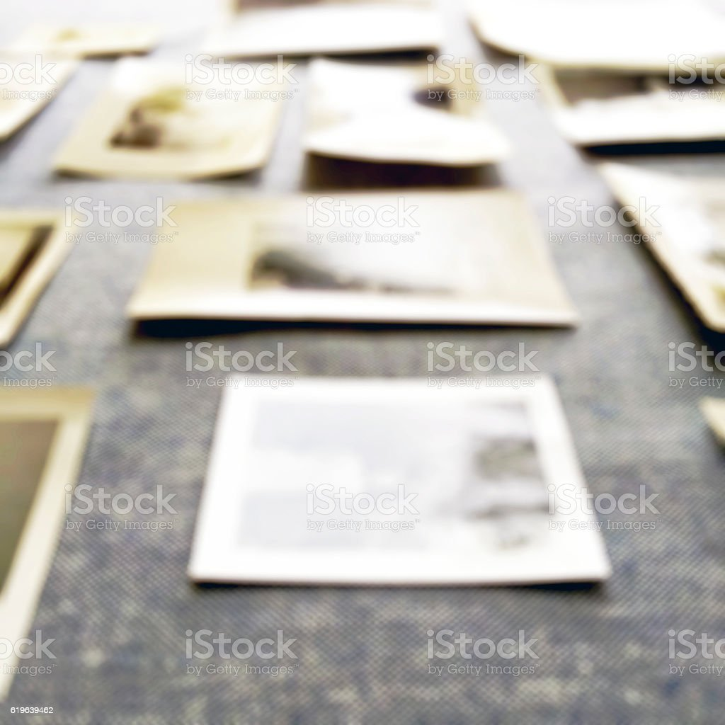 Old Photographs on Table Defocused stock photo