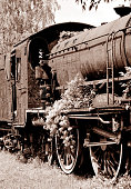 Old photography of Abandoned old locomotive on the railroad siding