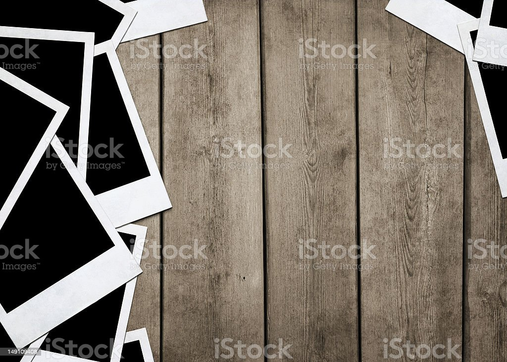 Old photos at wooden background stock photo