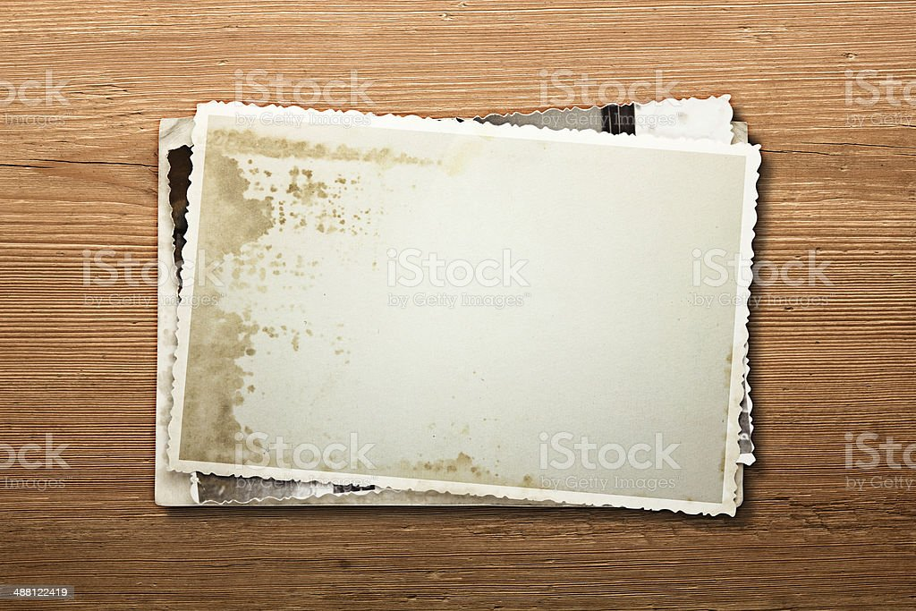 old photos on a wooden background stock photo