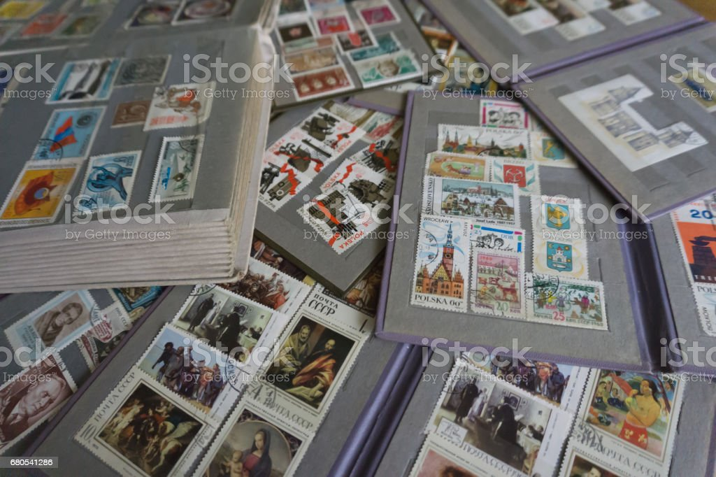 Old phylatelic albums with postmarks from different countries stock photo