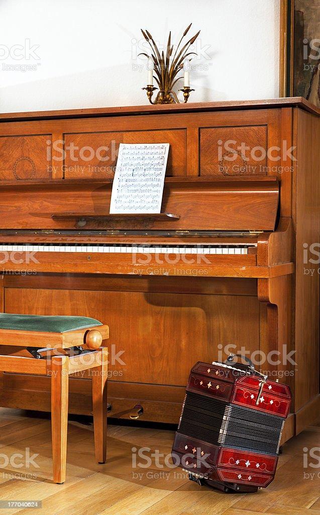 Old piano and bandoneon stock photo