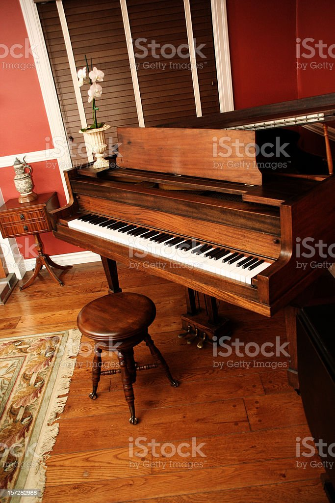 Old Piano in Red Room royalty-free stock photo