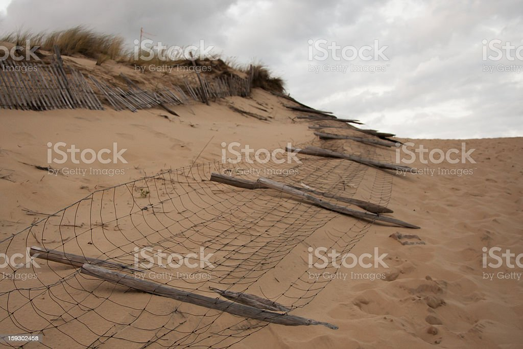 Old Picket and Wire Fences Along Sand Dune stock photo