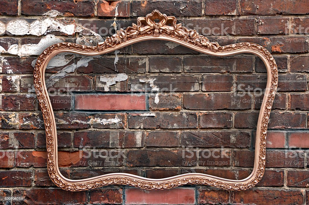 Old picture frame a a grunge red brick wall stock photo