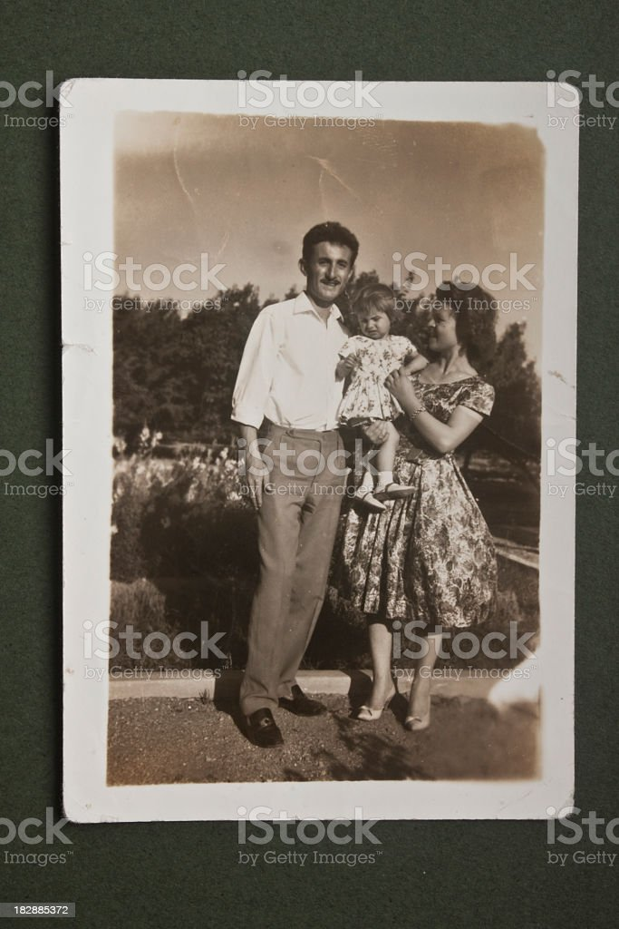Old picture of family posing together stock photo