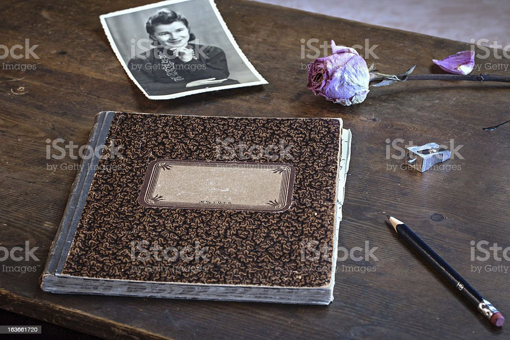 Old Picture, withered rose and diary royalty-free stock photo