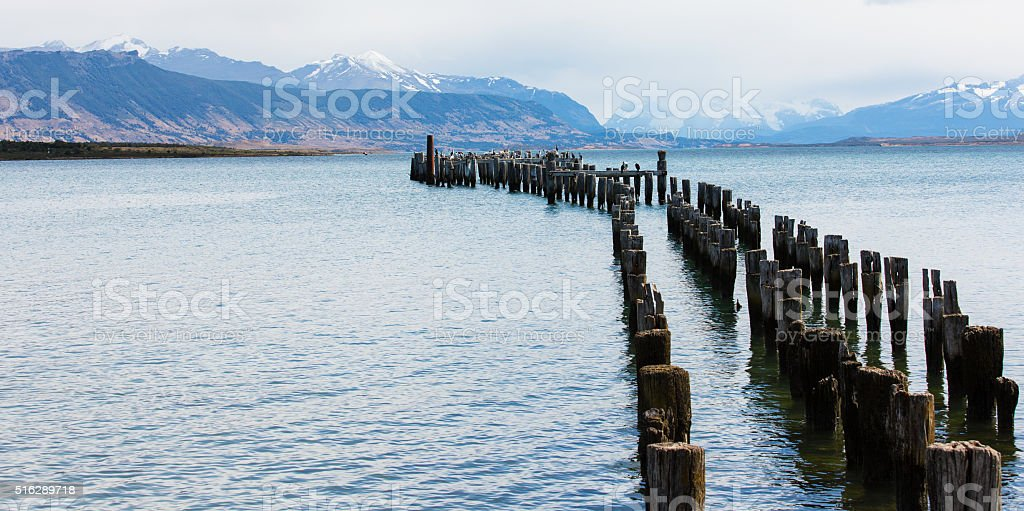 old pier at puerto natales stock photo