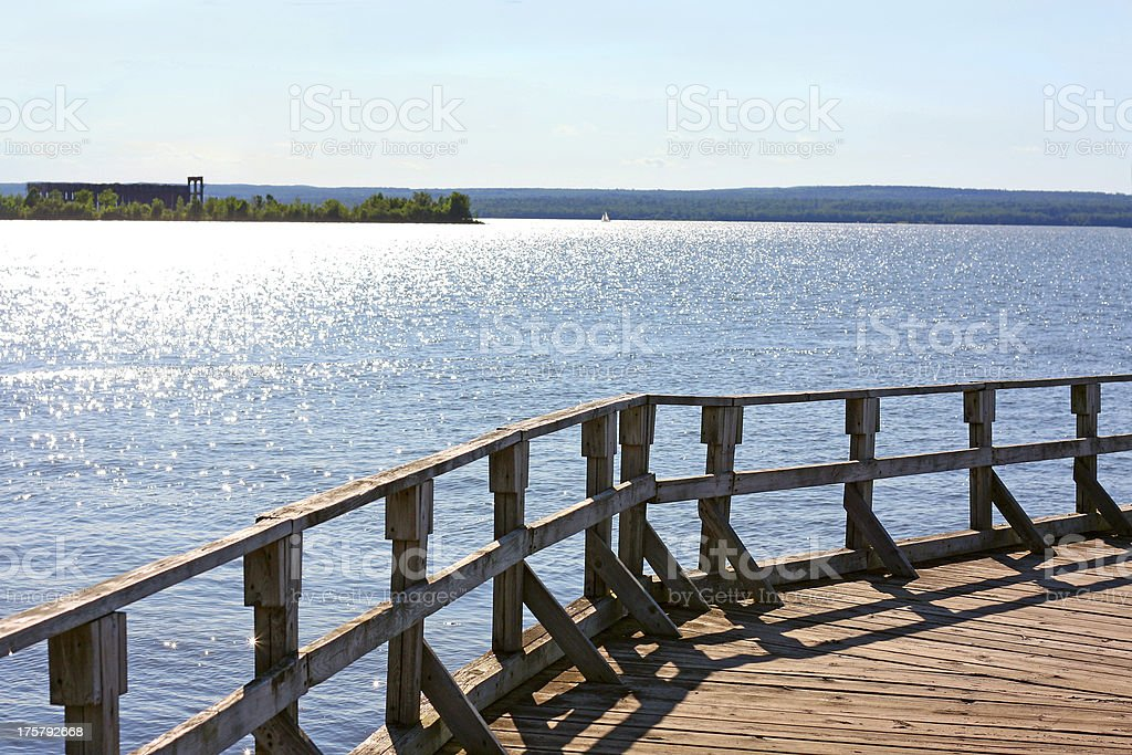 Old Pier on A Glistening Lake royalty-free stock photo