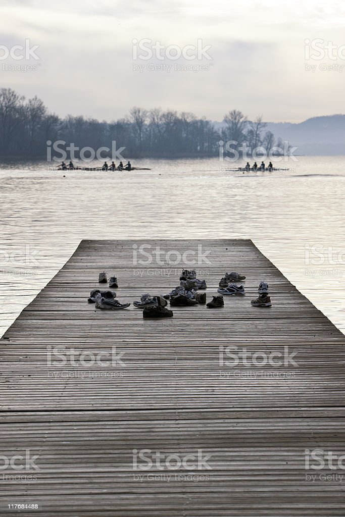 Old Pier with Shoes of Kayakers During Training stock photo