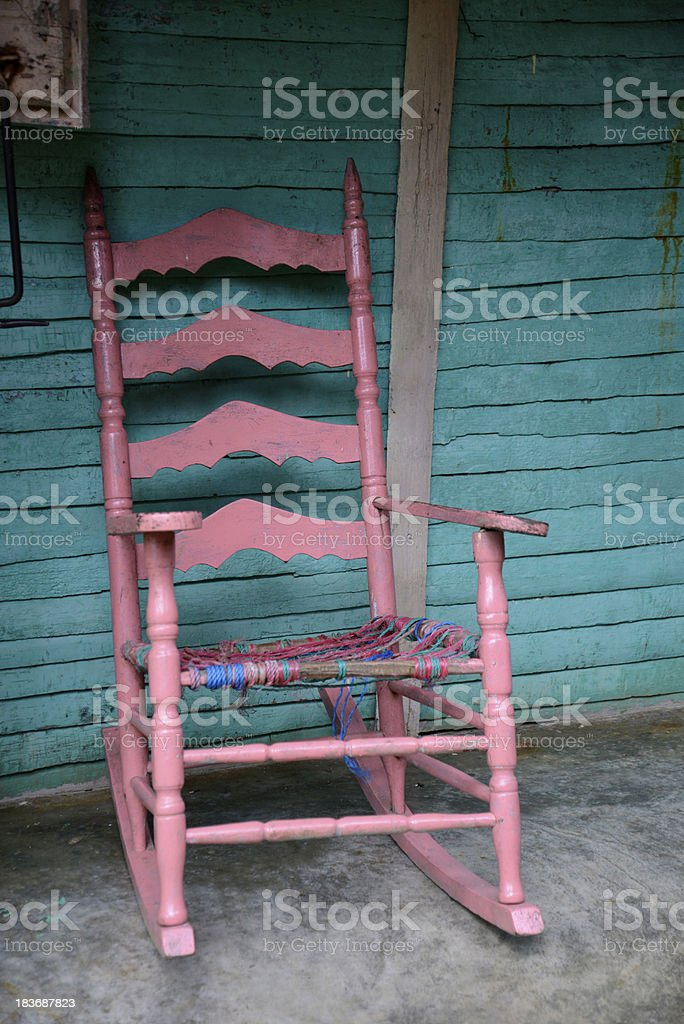 old pink rocking chair stock photo