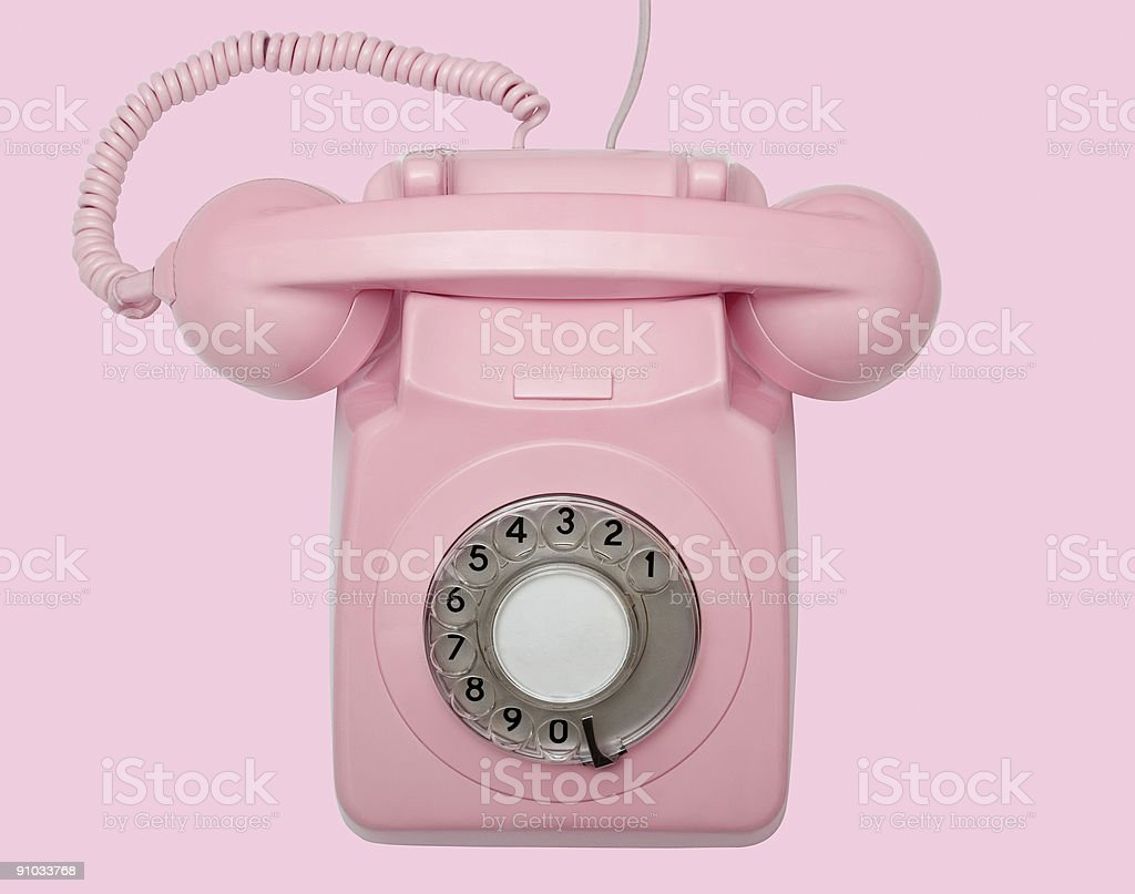 Old pink telephone on pink background with path royalty-free stock photo