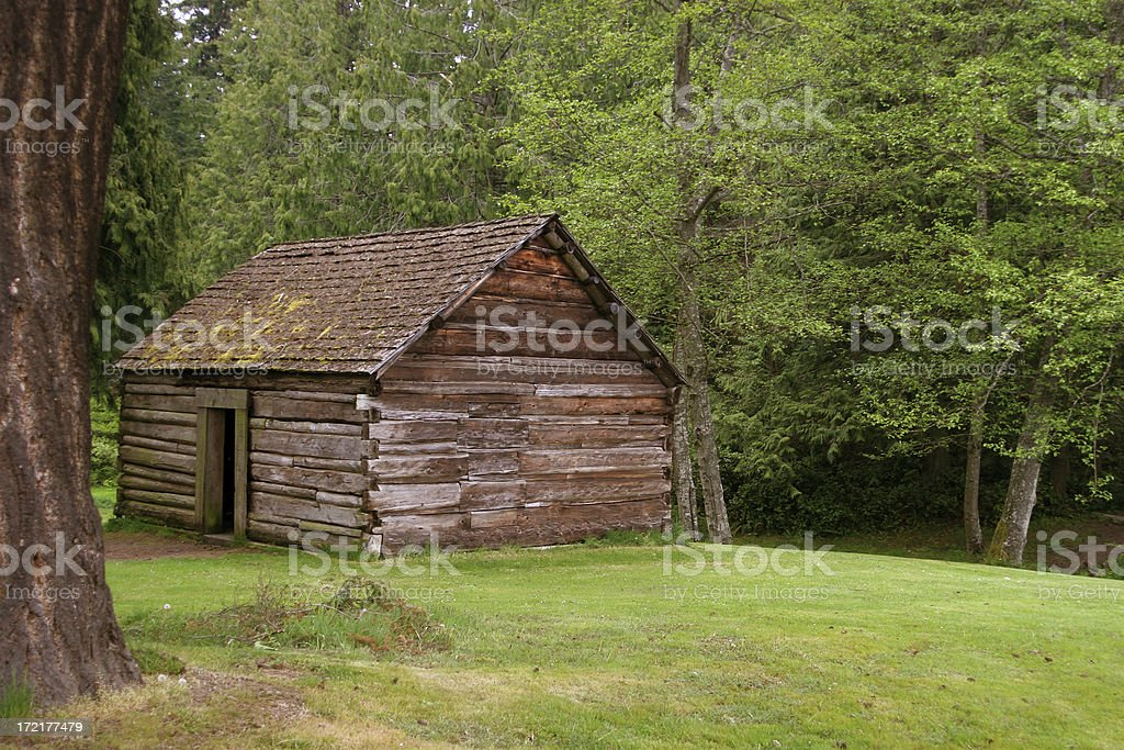 Old Pioneer Log Cabin In The Woods stock photo