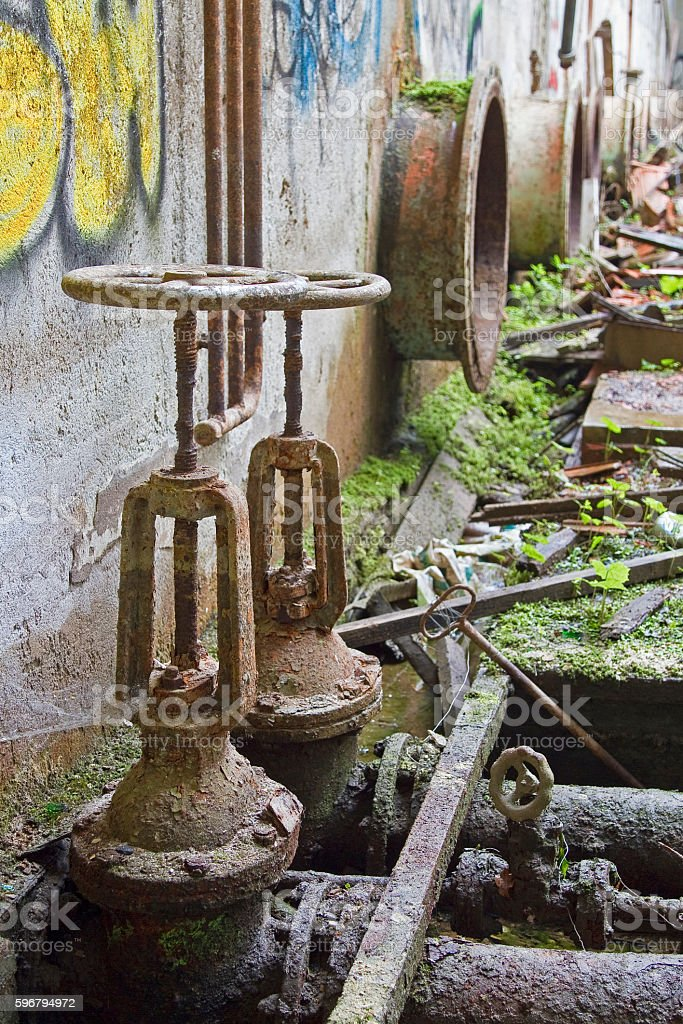 Old pipelines in a ruin stock photo