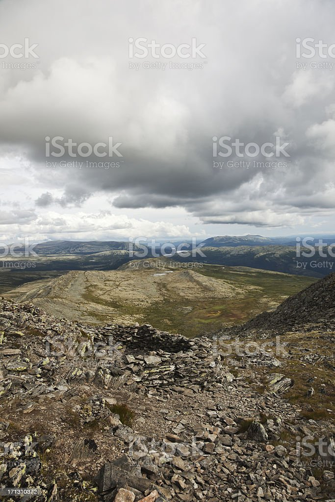 Old pitfalls in the mountains. stock photo