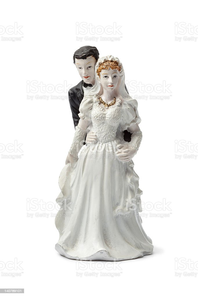 Old plaster bride and groom cake topper stock photo