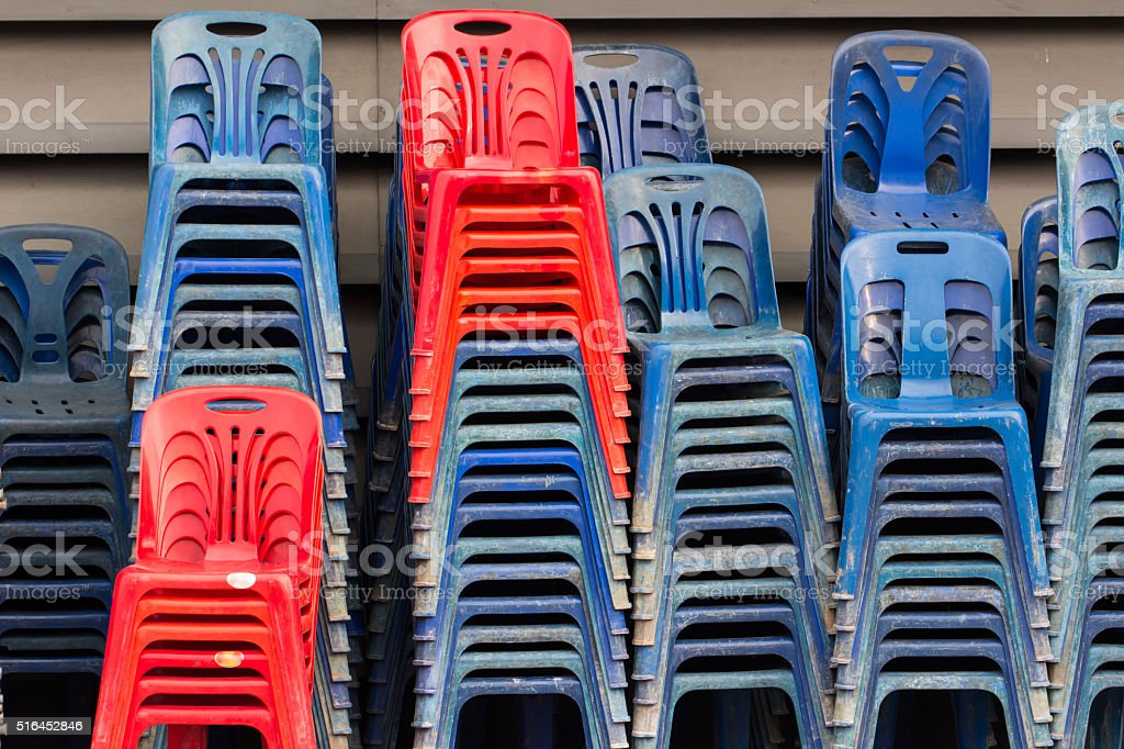 old plastic chairs blue and red stock photo