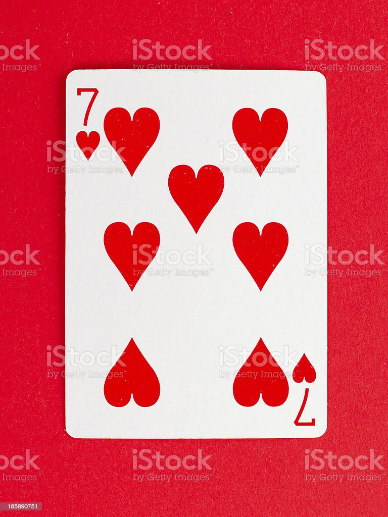 Old playing card (seven) stock photo