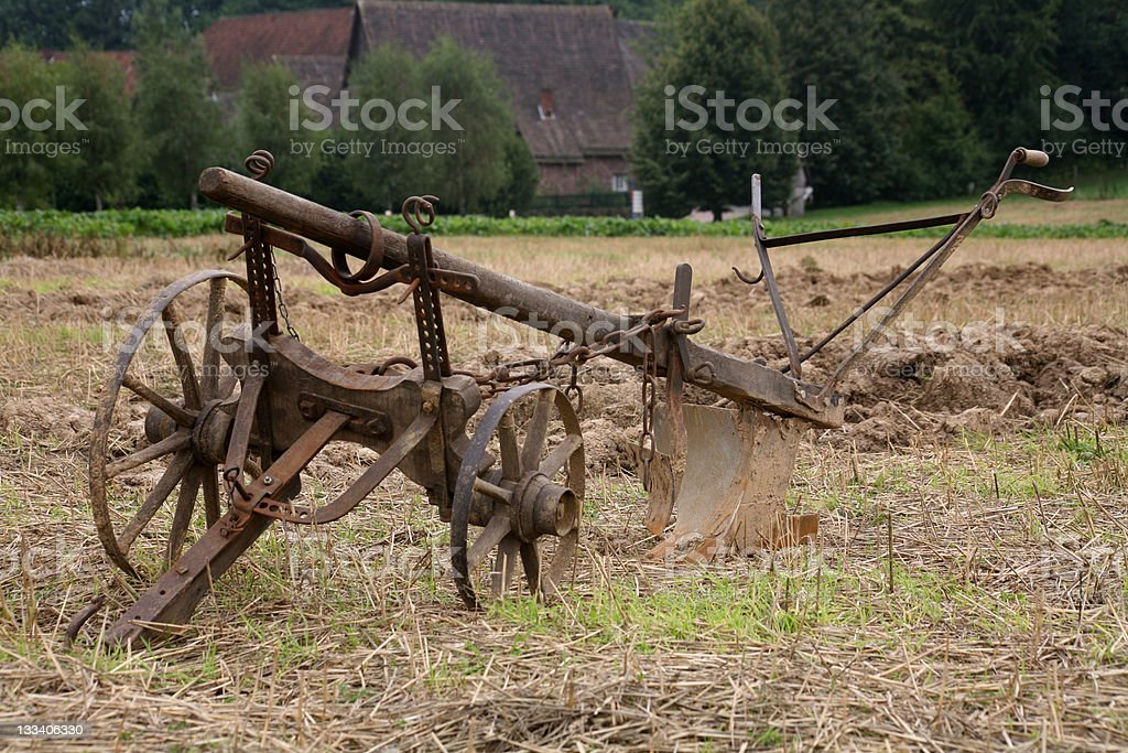Old plow in a field stock photo