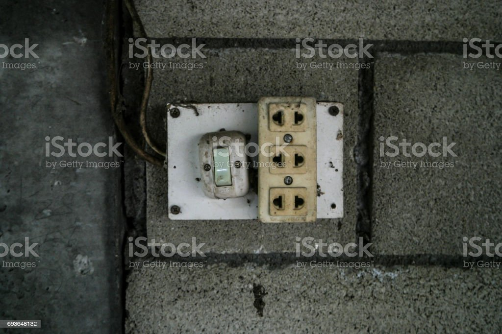 Old plug and Power switch in the room. stock photo