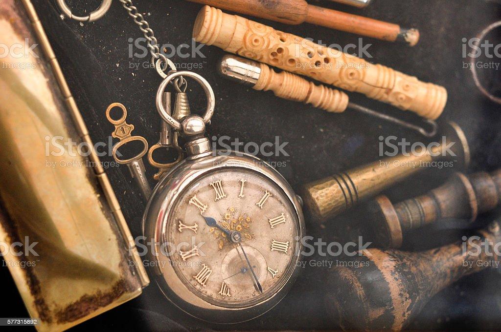 old pocket watch and flea market stuff stock photo
