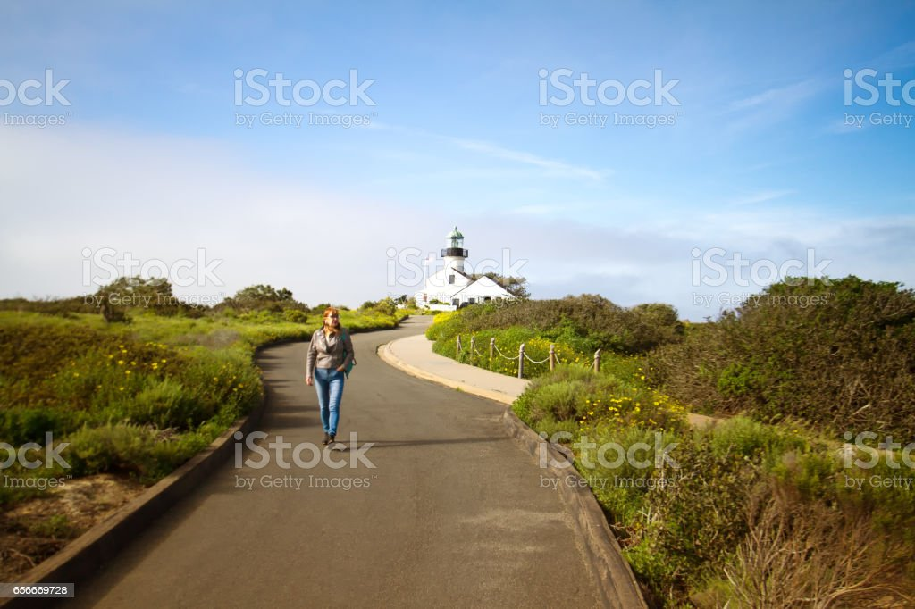 Old Point Loma Lighthouse, San Diego, with Approaching Tourist stock photo
