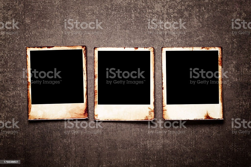 Old polaroids on grunge wall royalty-free stock photo