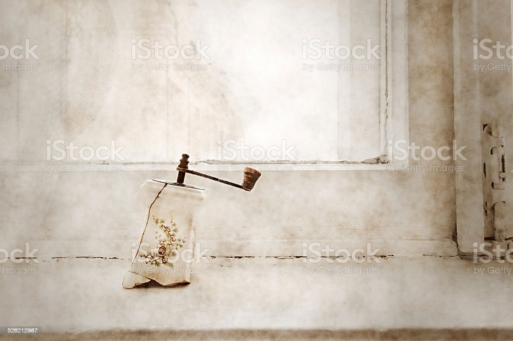 Old porcelain pepper mill in old stile stock photo