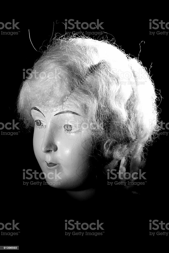 Old porcelan doll head spoted B/W stock photo