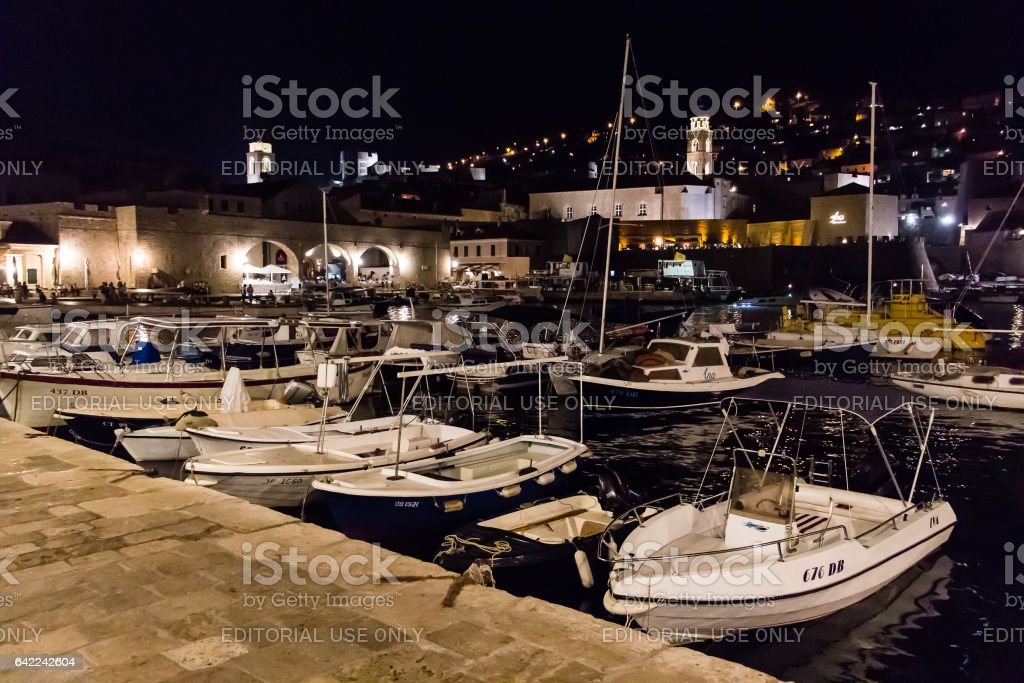 Old port and arsenal at night in Dubrovnik, Croatia stock photo
