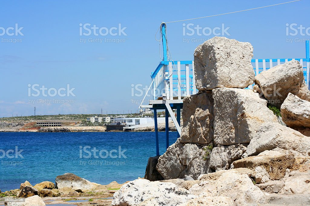 Old port on the Rocks with the sea stock photo