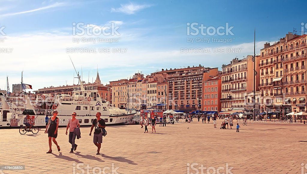 Old port (Vieux-Port) with people walking along the promenade stock photo