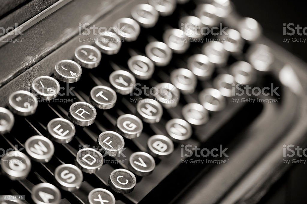 Old portable typewriter keyboard, side view from above. stock photo