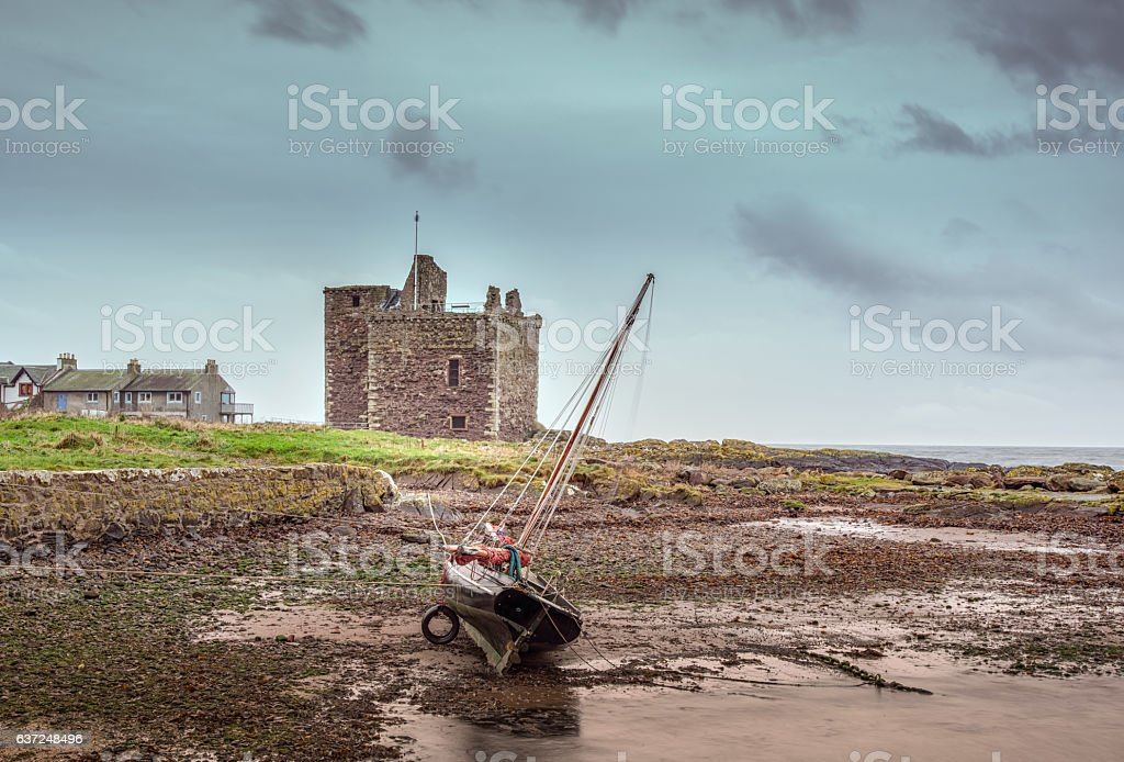 Old Portencross Castle And a Yacht at Low tide stock photo