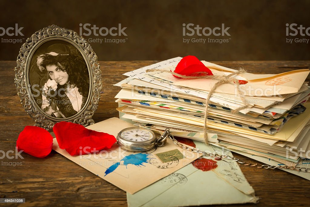 Old portrait and rose petals stock photo