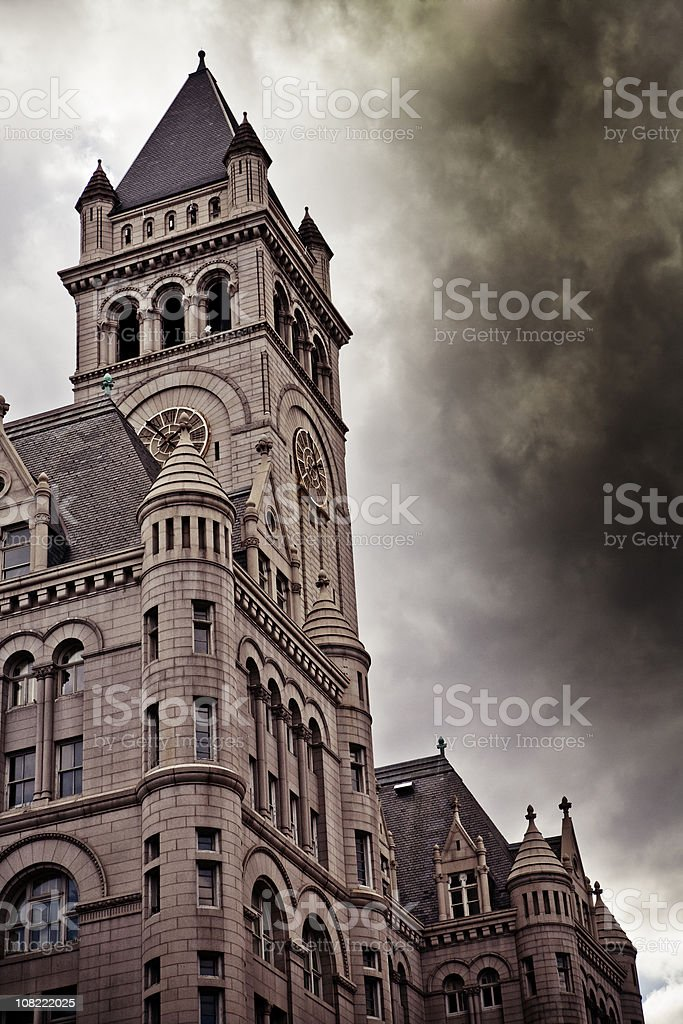 Old Post Office Building in Washington DC with Dark Clouds royalty-free stock photo