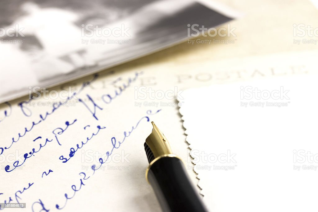 Old postcard and pen royalty-free stock photo