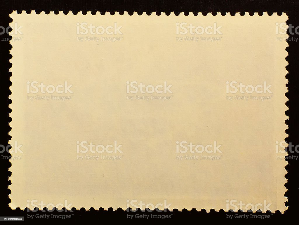 Old posted stamp reverse  side isolated on black background stock photo