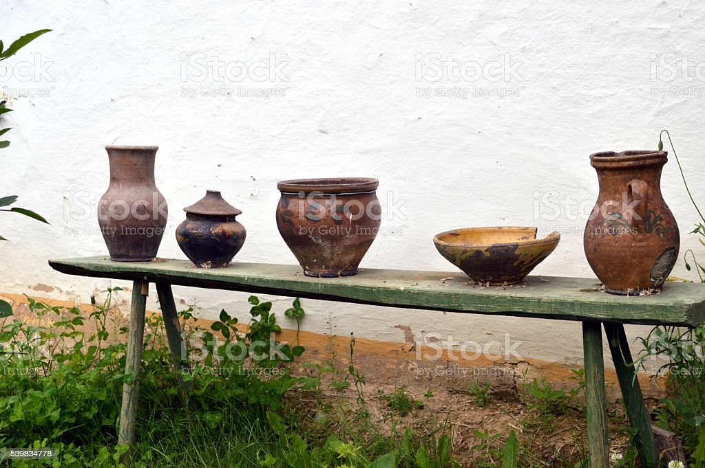 old pottery sitting on the bench stock photo